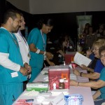 Students in the Medical Assisting Program of Four-D college conducting free health screenings.