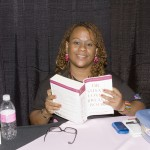 Felecia Malone of Choice Medical Group, reading Dr. Love's Breast Book