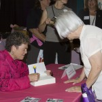 Dr Susan Love signing her book