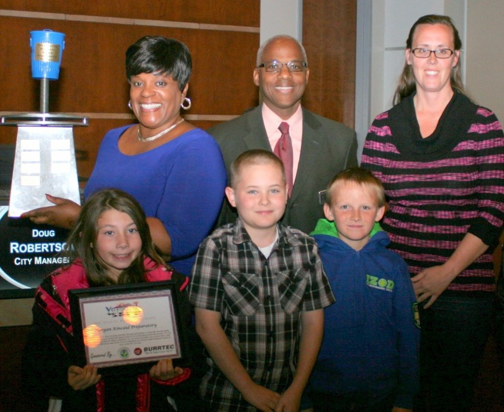 Teacher Vicki Bell, Principal Gerald Shaw, Parent Repre-sentative Sue Morgan and students from Morgan Kincaid accepting the traveling trophy as the top point winner.