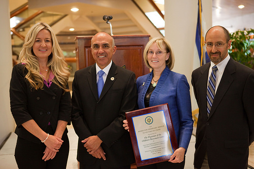 Doctors from the Children's Assessment Center receive the Award for Exemplary Service to Victims of Crime. From left to right: Dr. Amy Young, District Attorney Mike Ramos, Dr. Clare Sheridan and Dr. Mark Massi.