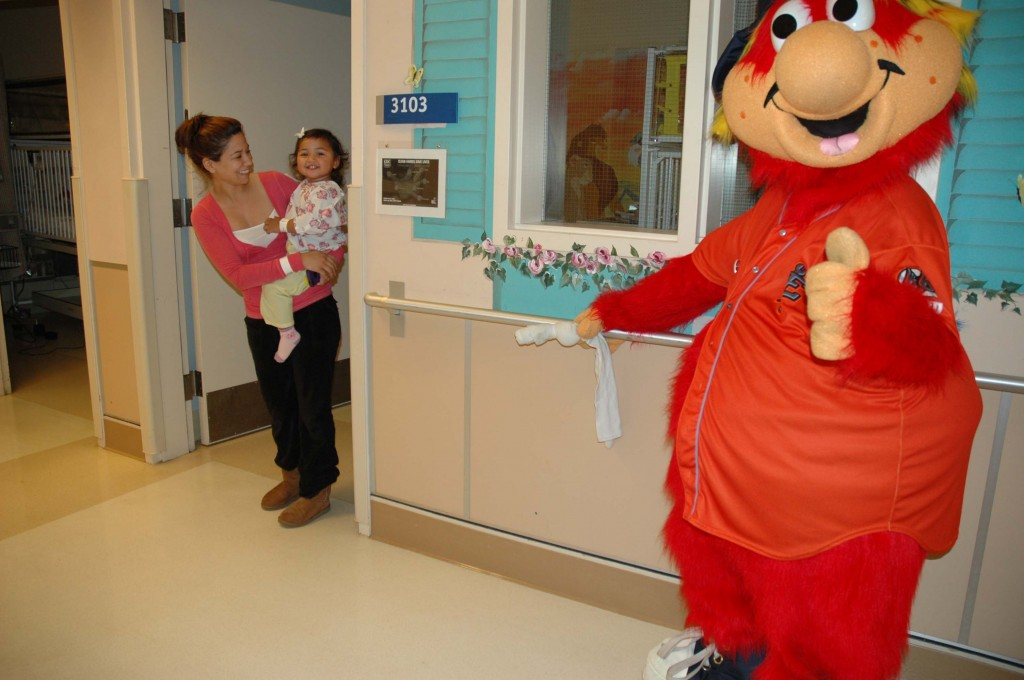Arianna Ramos, 1, visits with Inland Empire 66ers mascot, Bernie, on May 8, at Arrowhead Regional Medical Center's Pediatrics Unit. Bernie came to ARMC to help kick off a baseball Fundraiser Night, which is being hosted by ARMC's Volunteer Auxiliary and the Inland Empire 66ers on June 28 at San Manuel Stadium in San Bernardino. The event will help raise funds for a new state-of-the-art diagnostic tool for ARMC's Breathmobile® program.