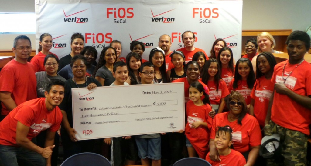 Volunteers from Verizon FiOS spent the day Saturday with students and parents at the Cobalt Institute of Math & Science in Victorville to improve the school's library.  The organization donated $5,000 as part of its initiative to give back to the Southern California communities it serves.