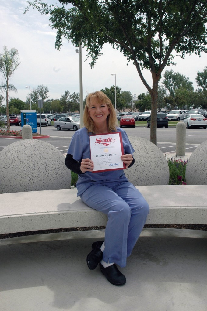 Arrowhead Regional Medical Center (ARMC) registered nurse Cheryl Meis, holds her Woman of Distinction award, which was presented to Meis at the 2014 Women of Distinction Awards Ceremony held recently at the National Orange Show in San Bernardino. The annual event recognizes women from throughout the region who demonstrate a strong commitment to their communities.