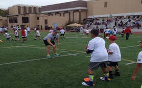 Sophomore Linebacker Nick Kosik demonstrates to a group on ball handling.