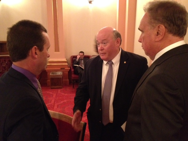 Supervisor Robert A. Lovingood, center, speaks on the floor of the California Senate with State Senators Steve Knight, left, and Mike Morrell, right.