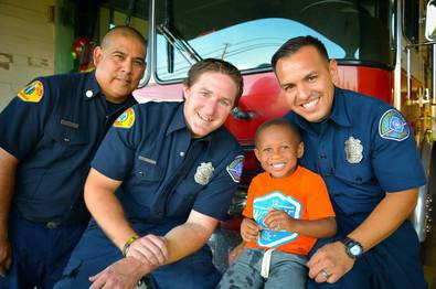 Johnnython pictured with his heroes, City of Colton firefighters, for the Heart Gallery.