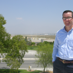 Mike Burrows, new acting executive director of IVDA, above San Bernardino Int'l Airport and IVDA project area along Tippecanoe Avenue.