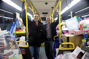 Steve Pusey (Deputy District Director-Maintenance) joins Basem Muallem (District 8 Director) in the District 8 stuffed Omnitrans bus.