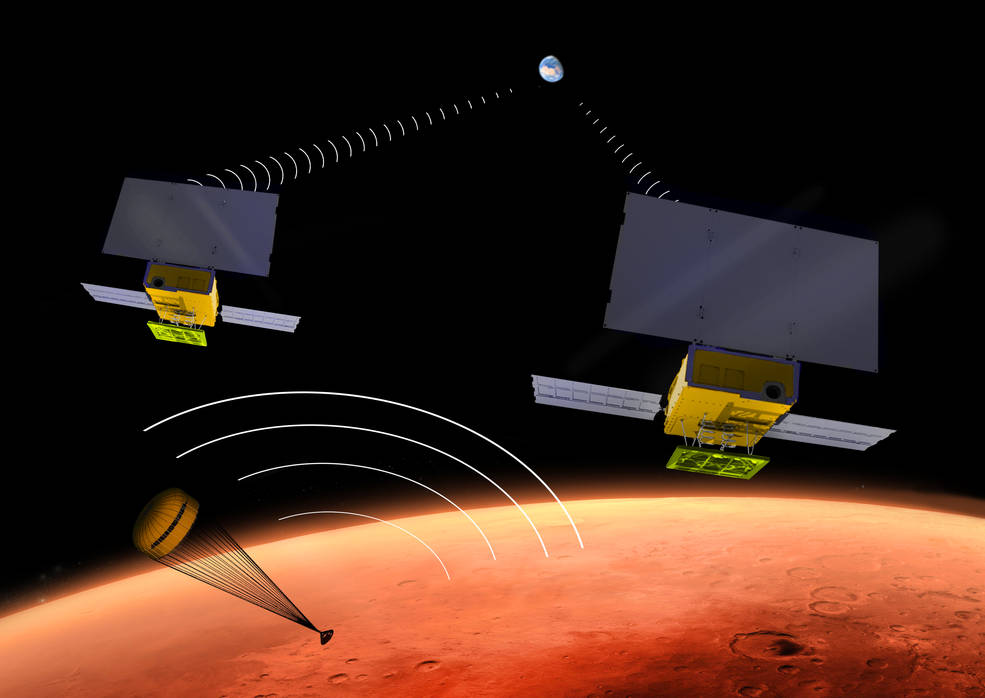 NASA's two small MarCO CubeSats will be flying past Mars in 2016 just as NASA's next Mars lander, InSight, is descending through the Martian atmosphere and landing on the surface. MarCO, for Mars Cube One, will provide an experimental communications relay to inform Earth quickly about the landing. Credits: NASA/JPL-Caltech