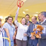 Sup. Gonzales cuts the ribbon with Mayor Richard Delarosa (right), ARMC staff, and other event participants.