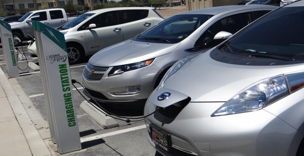 Two Leafs and a Volt charge up in the MDAQMD's rear parking lot.
