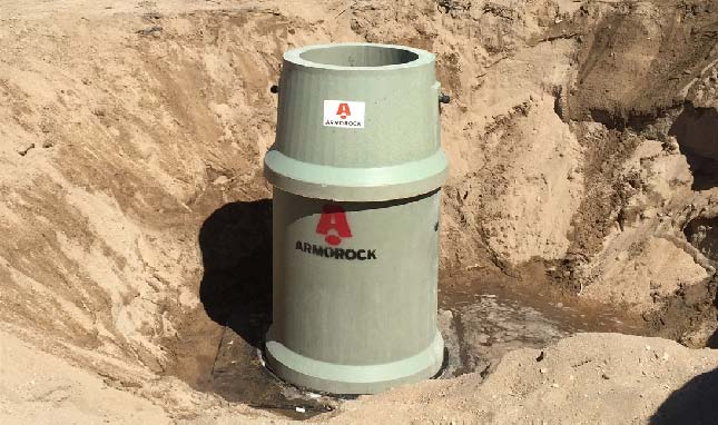 New polymer Armorock manhole installed near Interstate 15 and E St.