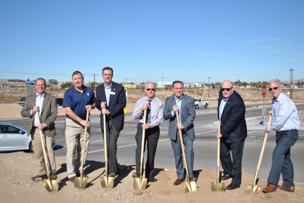 Pictured at the corner of Francesca and Spring Valley Parkway are representatives from the City of Victorville, County of San Bernardino and Spring Valley Association.  From left to right are Glenn Grabiec and Scott Eckert from Spring Valley Association, Don Holland from Supervisor Lovingood's Office, City of Victorville Engineer Brian Gengler, City of Victorville Council Member Ryan McEachron, First District Supervisor Robert Lovingood and Victorville City Manager Doug Robertson. PHOTO CREDIT:  Robert Horney