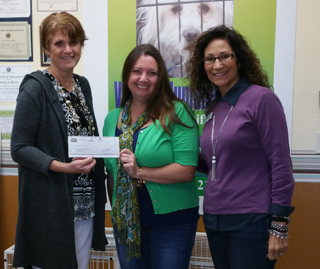 Rachelle Allen presents a $5,000 Disney VoluntEARS Community Fund grant to VVAPL Humane Society Executive Director Kathy Williamson (left) and VVAPL PR Rep. Terry Saenz (Right)