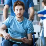 Young-Man-in-Wheelchair-300x200