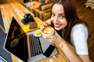 Woman-in-coffee-shop-with-computer-300x200