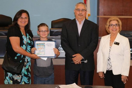 Aaron Hanson, a fourth-grade student at Discovery School of the Arts, was awarded second place in the City of Victorville's Public Works Essay Contest.  Pictured from left to right are:  Johnette Ellis, Support Specialist with the Victor Elementary School District; Aaron Hanson; Joe Flores, Victorville Public Works Manager; and Victorville Mayor, Gloria Garcia.