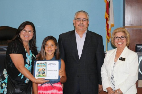 Madison Young, a fourth-grade student at Liberty School of Creativity and Innovation won third place in the City of Victorville's Public Works Essay Contest.  Pictured from left to right are:  Johnette Ellis, Support Specialist with the Victor Elementary School District; Madison Young; Joe Flores, Victorville Public Works Manager; and Victorville Mayor, Gloria Garcia.
