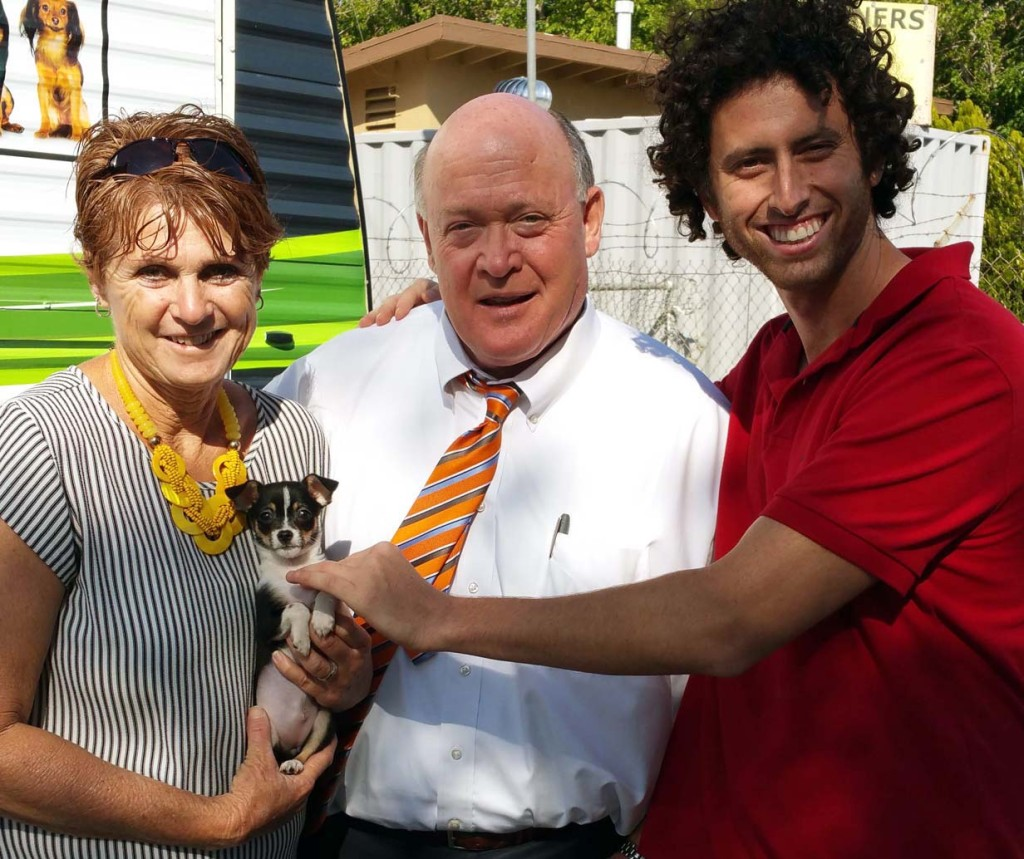 (Left) VVAPL Humane Society Executive Director Kathy Williamson holds one of the puppies available during the adoption event, First District County Supervisor Robert A. Lovingood, and a potential pet parent.