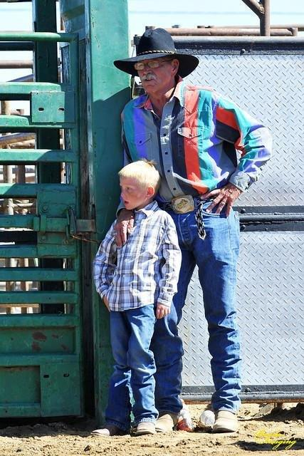 Adelanto Mayor Rich Kerr and his grandson at the first Adelanto Rodeo; awaiting the muttin' busting competition