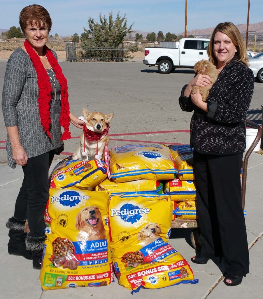 ICR Staffing Services, Inc. President Melanie Lovingood presents a 500-pound food donation to VVAPL Executive Director Kathy Williamson and Ambassador Dog Millie.