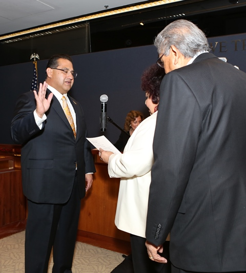 Supervisor Ramos is administered the oath by his mother, Mrs. Rowena Chacon Ramos.