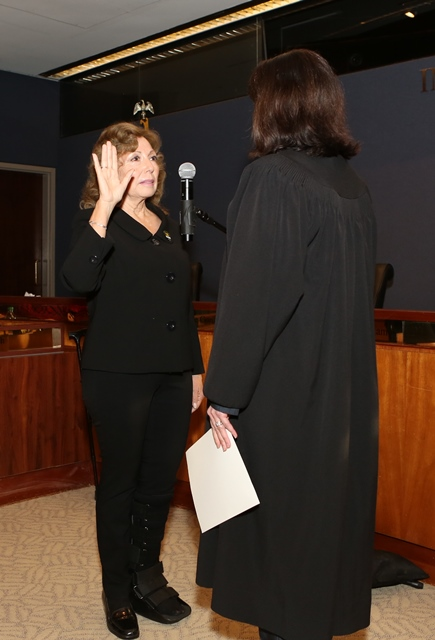 Supervisor Gonzales is administered the oath by Annemarie G. Pace, Judge of the Juvenile Dependency Court.