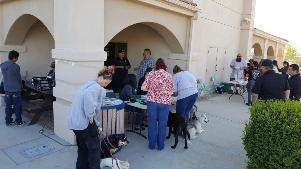Adelanto Residents lining up for pet vaccinations, licensing and micro-chipping tables at City Hall on March 18.