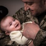 Soldier-with-Child-300x279