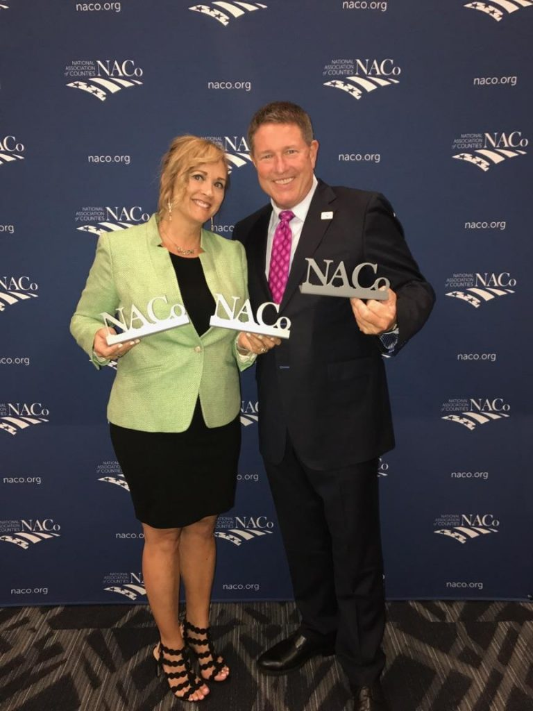 Photo_Veronica-Kelley-DBH-Director-and-Brian-Desloge-NACo-President-768x1024