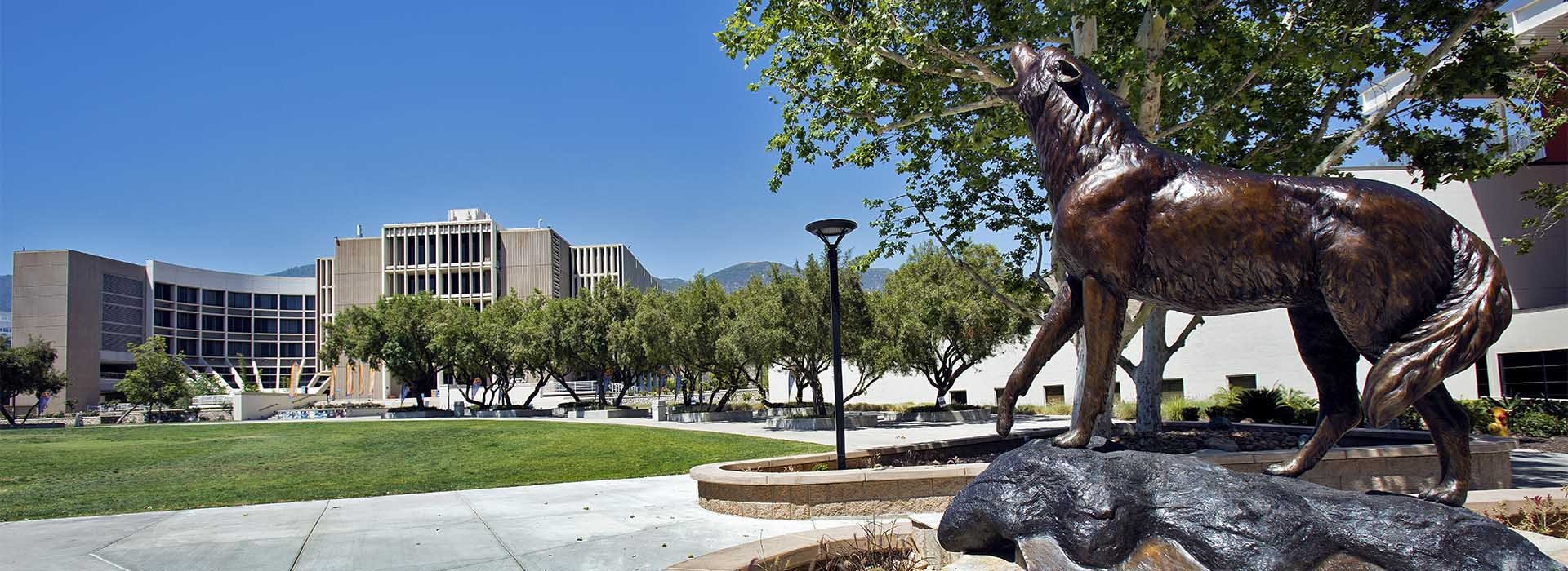"16-06-04-CSUSB-- Coyote ""Wild Song"" statue outside the Santos Manuel Student Union (SU) at California State University, San Bernardino on Saturday, Jun 4, 2016. Photo by Corinne McCurdy/CSUSB"